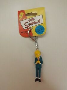 The Simpsons - Mr Montgomery Burns keyring with red / yellow label - NEW