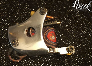 Polished Steel tattoo machine with Marine Corps themed coil covers over 9 wrap
