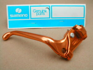 NOS BMX SHIMANO PRE BENT BRAKE LEVER RIGHT HAND SIDE  GOLD NEW IN PACKET 1981->