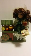 DAN DEE COLLECTOR'S CHOICE PORCELAIN DOLL WITH WOOD FRUIT CART  & COA