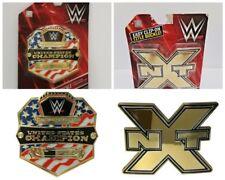 Lot of 2 - WWE United States Championship Belt Buckle & NXT Champion Belt Buckle
