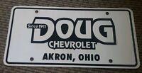 DOUG Chevrolet CHEVY GM Dealer License plate AKRON OHIO closed DEALERSHIP SERRA