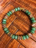 Classic 5x8mm Green Emerald, Clear Crystals, Bali Gold Beads. Stretch Bracelet