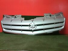 2005 - 2007 Cadillac STS  Light Silver grille w/chrome strip Used OEM  No Emblem