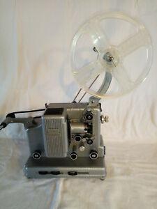 projecteur de film NIZO Cinemator avec sa mallette de transport