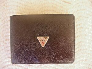 GENUINE LEATHER WALLET IT HAS THE GUESS USA EMBLEM ON THE FRONT GIVEN AS A GIFT