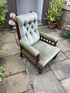 Victorian mahogany framed open arm library chair