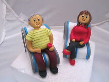 Anniversary couple hand made  figures on deck chairs edible  cake topper,