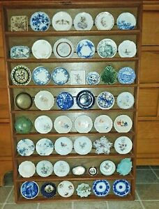Antique butter pats, 50, with handmade display shelf