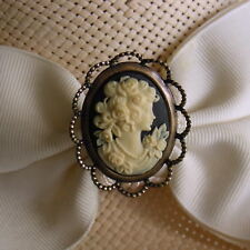 Hatpin With Ivory Color Lady On Black Cameo - Old Brass Finish