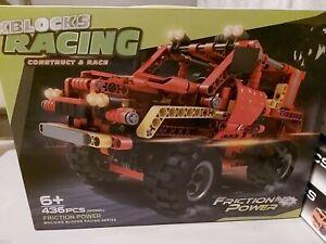 XBLOCKS RACING CONSTRUCT & RACE. FRICTION POWER BUILDING BLOCKS.  NEW - Orange.