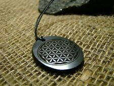 """Pendant shungit oval with laser engraving """"Flower of Life"""""""