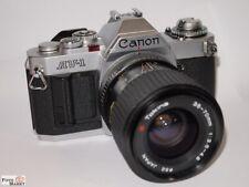 Canon AV-1 SLR Kamera mit Zoom-Objektiv Tokina 35-70 mm 1:3,5-4,8 Ø 52mm