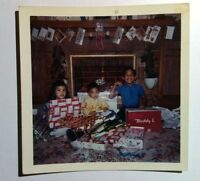 Vintage 60s Photo Cute Asian Kids Unwrapping Christmas Gifts Showing Off Muscles