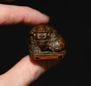 Antique Japanese carved lacquer netsuke of a ShiShi, Edo period, 19th Century.