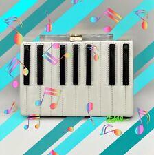 KATE SPADE FANCY FOOTWORK PIANO KEYS CLUTCH