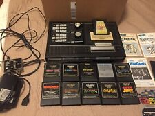 COLECOVISION GAME CONSOLE WITH 11 GAMES AND SOME INSTRUCTIONS BOOKS