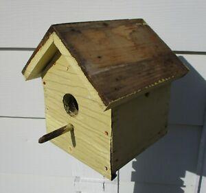 vintage handmade wood birdhouse yellow paint old weathered aluminum front