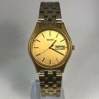 Read Seiko Mens 7N43-9048 Gold Tone Stainless Steel Day Date Quartz Wristwatch