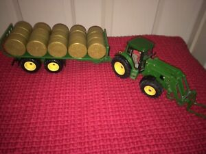 Siku Metal Tractor with Fork, Flat Trailer & Bales