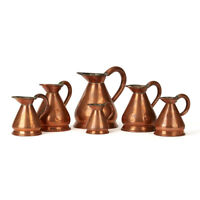 SIX VINTAGE GRADUATED COPPER MEASURING JUGS EARLY 20TH C.