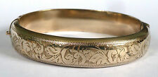 A VINTAGE GOLD PLATED OPENING BANGLE WITH AN ENGRAVED SCROLL DESIGN