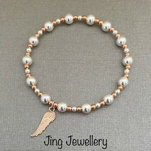 Sterling Silver & Rose Gold Beaded Stretch Bracelet Angel Wing Charm