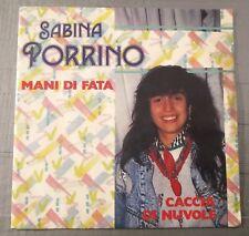 Sabina Porrino – Mani Di Fata / Caccia Di Nuvole 45 giri Italo Disco  GDR