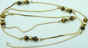 31 inch long 9 carat yellow gold chain necklace with tigers eye and gold beads.