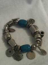Elasticated Metal and Blue Stone China/ Tibet Themed Bracelet. (J241)