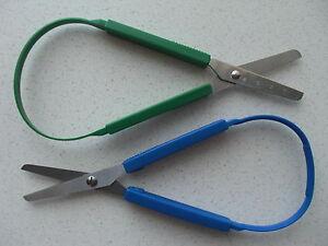 Easy grip self opening loop scissors left or right handed