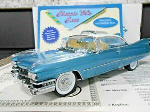 """Danbury Mint 1:24 1959 Cadillac Coupe De Ville """"Vegas Turquoise & Dover White"""""""
