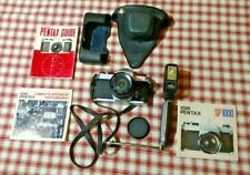 Asahi Pentax SP1000 35mm SLR camera with lens, case and books, flash and handle