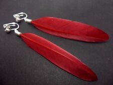A PAIR OF LONG DARK RED  FEATHER  DANGLY CLIP ON EARRINGS.