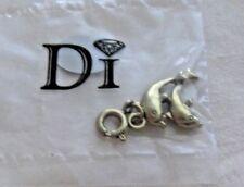 DI DIAMONDS INTERNATIONAL DOLPHINS CHARM  NEW IN PLASTIC