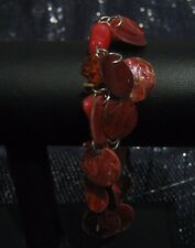 Lovely elasticated bracelet many pretty red stained shell discs
