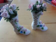 pair of ceramic boots with roses