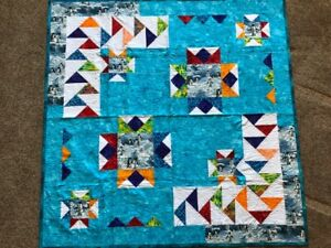 Penguins on Ice Lap Quilt:  54 inches by 54 inches