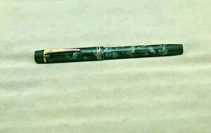CIRCA 1948 ONOTO FOUNTAIN PEN IN BLUE AND BLACK MOTTLED WITH PISTON FILL