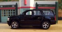 New Welly Approx. 1/43 Scale Diecast Black Chevrolet Tahoe