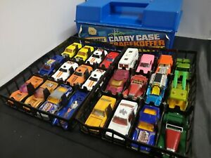 B824-MATCHBOX PLASTIC CARRY CASE WITH TWO TRAYS OF VEHICLES INCLUDED