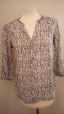 Magnifique chemisier motif léopard MAISON SCOTCH taille 1 en très bon état.