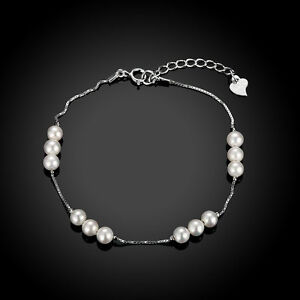 NEW ARRIVAL 925 STERLING SILVER BRACELET WITH 12 WHITE SHELL BEADS DESGIN