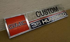 NOS 1973-1974 GMC Custom 35 Hundred Fender Emblem