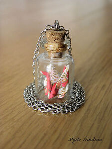 Origami crane in a bottle pendant
