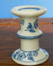 A hand painted blue and white porcelain candle holder