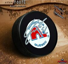 ADAM FOOTE Signed Quebec Nordiques Puck - Colorado Avalanche