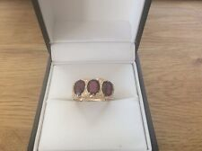 9ct Gold ring set with 3 Garnet stones size T1/2