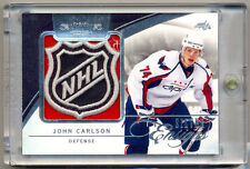 2010-11 Dominion Silver Ensigns JOHN CARLSON Game Used NHL Logo Shield 1/1 CAPS!