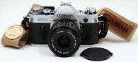 Canon AE-1 Chrome 35mm Film SLR camera c/w FD 50mm f/1.8 Lens Kit & Straps -Mint
